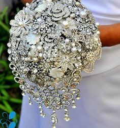 Brooch bouquet - awesome idea so you don't waste so much on flowers. And you could save forever