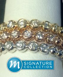 Stackables diamonds part way around, bubble motif band, $450