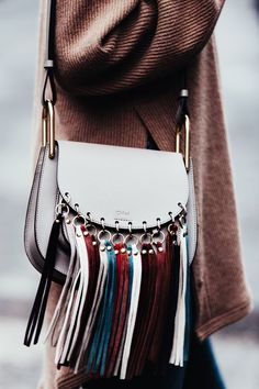 Statement handbag with fringes from Chloé. Clothing, Shoes & Jewelry : Women : Handbags & Wallets http://amzn.to/2lvjsr9