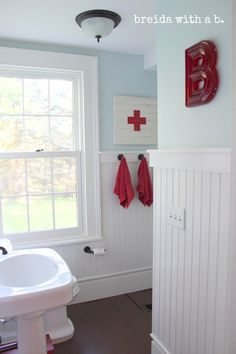 Red, white, and pale blue bathroom.
