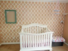 Looking to add an accent wall to your nursery? Check out this stenciled Wall design. #babyroom #nursery #accentwall