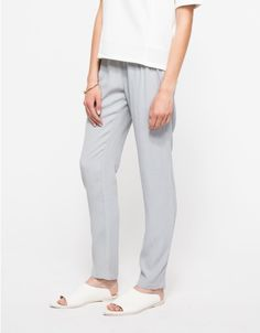 From Just Female, a lightweight pant with subtle allover texture and minimalist style. Features an elasticized waistline, front pockets, tapered fit through the leg and relaxed fit.  • Lightweight pant with allover texture • Elasticized waistline • Fr