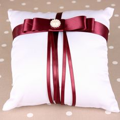 Burgundy & Ivory Ring Cushion with Pearl/Diamante embellishment. Satin Wedding Ring Cushion decorated with satin ribbon to match your wedding scheme.