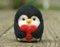 This earnest penguin, eager to share his glass of wine, is carefully needle felted from soft wool. Little and cute, it measures 2 inches tall and