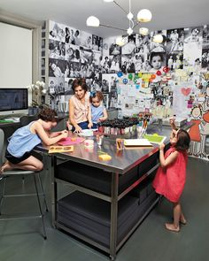 A stainless-steel table acts as an island of creativity in the middle of the room. The shelves underneath hold large cloth-covered boxes - Space Crafts, Home Crafts, Craft Space, Home Office, Office Table, Stainless Steel Table, Color Crafts, Table Storage, Storage Spaces