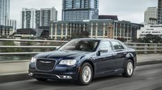 """2015 Chrysler 300C_""""American""""_Why the quotes? Because the 300C is built in Canada by an Italian conglomerate based in Belgium. Its Hemi V8 is assembled in Mexico"""