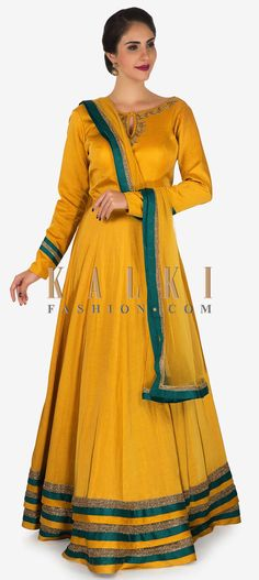 Buy Online from the link below. We ship worldwide (Free Shipping over US$100) Click Anywhere to Tag Mustard anarkali suit in silk beautified in zardosi and moti embroidery work only on Kalki Opt for a complete chic appeal in your bestie's sangeet as you twirl around in this mustard anarkali suit. The suit is featured in silk fabric. It is embellished in zardosi and moti embroidered work at the neckline with a decorated cutdana hem borders that is further highlighted with green. It flaunts a…