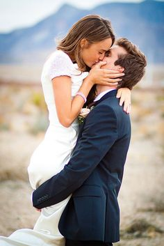 I love when the groom lifts the bride for a photo! I will most likely have this kind of photo in my engagement photos.