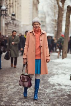 Choose an orange coat and a blue skater skirt for a refined yet off-duty ensemble. Round off this look with blue leather knee high boots. Shop this look on Lookastic: https://lookastic.com/women/looks/coat-turtleneck-skater-skirt-knee-high-boots-satchel-bag-beanie/8950 — Grey Embellished Beanie — Orange Knit Turtleneck — Orange Coat — Blue Skater Skirt — Burgundy Woven Leather Satchel Bag — Blue Leather Knee High Boots