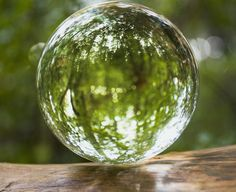 How To Use a Crystal Ball for Good Feng Shui: A clear quartz crystal ball can be a true embodiment of perfection, harmony and light. In feng shui, crystal balls bring the energy of harmony and balance to any space.