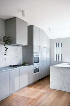 This restored worker's cottage in Brisbane's heart proves there's plenty to gain by honouring the past. With an internal redesign, clever window magic and a palette that focuses on improving light and space, the home has received a modern reinvention. Modern Grey Kitchen, Timber Kitchen, Minimalist Kitchen, Kitchen And Bath, Kitchen White, Minimalist Design, Grey Kitchens, Cheap Furniture, Kitchen Furniture