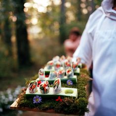 vegetarian spring rolls were placed in zucchini boats atop a bed of moss and flowers. Thai Spring Rolls, Veggie Spring Rolls, Summer Rolls, Wedding Food Catering, Catering Food, Catering Events, Catering Ideas, Catering Recipes, Wedding Snacks