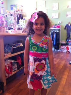 This cutie is just loving her new Desigual dress and new headband. www.theantandthegrasshopper.ca