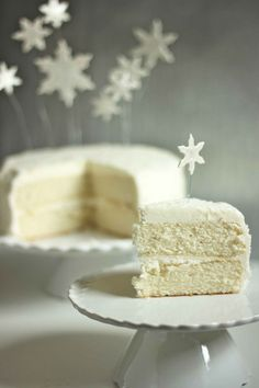 White Christmas Cake Recipe ~ Says: The cake is a a fluffy vanilla cake.  It's a delicate white cake with the perfect crumb, and it is oh-so-fluffy.  The frosting is a whipped vanilla frosting that is super light and airy, just like snow.  It is the best vanilla cake I've ever had.  Did you hear me?  The best... Anytime of the year!