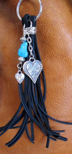 #ThePaintedCabeza ~ This handmade tassel charm can be used on your purse, backpack, zipper, wherever youd like to add some charm! Its made up of black suede, natural turquoise stone, and silver plated charms. Altogether, the charm is approximately 8.75 long.