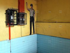 [photo by Zrf] Picture of a law enforcement officer on a wall in Kota Kinabalu, Malaysia