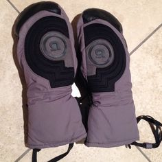 Burton mittens purple/grey/black size medium Burton mittens purple/grey/black size medium. Super warm! Individual finger slots inside. Wrist straps attach to your jacket so you don't lose a glove on the ski lift. Internal compartment for wrist brace or inserting hand warming packs. Small wear spot on left thumb shown. Otherwise excellent condition. Waterproof. Ski gloves , snowboard gloves.  All my items are cross-listed on ️oshmarkⓂ️ercari⭕️fferUp, so get them while you can! ✨Open to…