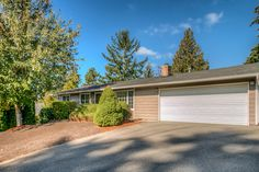 Immaculately maintained & updated rambler in the desired Finn Hill neighborhood! Bright & airy home feature a potential MIL with vaulted ceiling, full bath, skylight, kitchenette & walk-in with separate entry. Open concept kitchen facing a spacious family room with laminate flooring