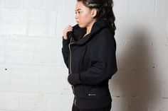 The Bia Initiation Jacket - $120 - Get initiated into the Society with Society Nine's first jacket. Featuring motorcycle-inspired asymmetrical gold zip; a high rise collar to keep you warm and a deep hood inspired by a boxer's robes. Constructed of a moisture wicking 88% polyester / 12% elastane moss jersey blend, this jacket maintains its shape while you put in the work.