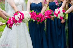 All of the bridesmaids' and the bride's hot pink floral bouquets | Lynda Berry Photography #Wedding