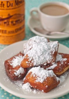 Beignets  makes about 2 dozen squares  1 envelope active dry yeast  3/4 cup water (110 degrees F)  1/4 cup granulated sugar  1/2 tsp salt  1 beaten egg  1/2 cup evaporated milk  3 1/2 – 3 3/4 cups flour  1/8 cup shortening  Vegetable oil for frying  powdered sugar for topping