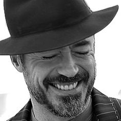 Robert Downey Jr.  Why? Because he reminds me of hope and perseverance, and he makes me smile:)