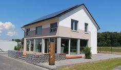 """In der Hausserie """"Oslo""""finden Sie dieses Musterhaus von der Kampa GmbH wieder."""