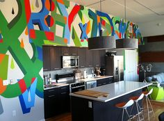 Add a splash of color to the kitchen with the graffiti wall - Decoist