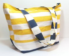 This is a Yellow and Navy Large Beach Bag, This Bag is REALLY BIG! It is big enough for 4-6 Beach Towels. You can customize it by choosing your favorite