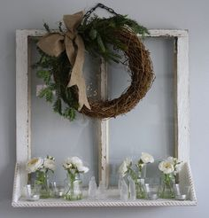 Grapevine wreath with greenery and burlap bow.-- change greenery to fall foliage for fall time