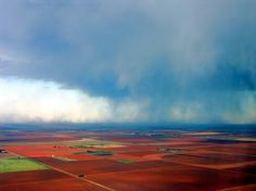 Aerial view of farm land around Lubbock, Texas with an incoming rain storm.