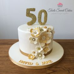gold and ivory flowers cake