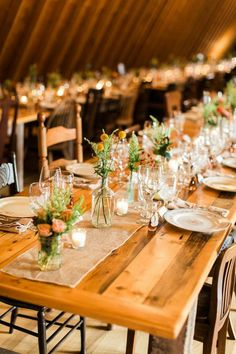 handmade farm style tables, assorted vintage chairs and assorted vintage china for a Catskill mountain barn wedding at The Inn.
