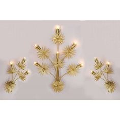 Three 'Gilded' Wall Lights, in the form of sprigs of stylised flowers, bunched at the bottom and branching out – the largest sold separately. valeriewade,com