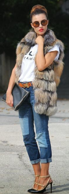 Attention fashionistas this post is for your you! A white tee, cuffed up capri jeans, brown leather belt, black studded clutch, sunglasses and a long grey brown fur vest with pointy Valentino heels is great for a casual day.