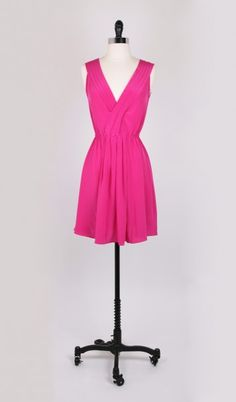 This dress is Pleated to Perfection in hot pink by Amour Vert