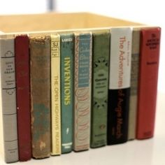"Recycle old books into new crafts - box with old book spines for ""secret"" storage"