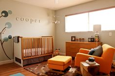 Modern nursery with neutral walls and beautiful orange accents! #nursery