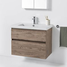 Twenty vanity offers a whole new modern look & style. Features an Italian-made ceramic top available in 4 types of bowls, timber veneer handles and soft-close drawers. Wall Hung Toilet, Wall Hung Vanity, Modern Baths, Modern Bathroom, Floating Vanity, Floating Wall, Stone Bath, Bath Screens, Bath Panel