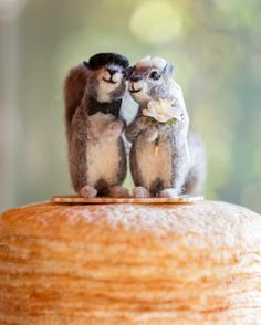 Guests went nuts over this custom-designed cake topper by Facci Designs. The groom adored the hand-felted squirrels, especially their details such as the French beret.