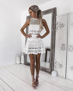 Everything about this dress is so amazing! The shape and cut out pattern all over makes this dress super interesting.