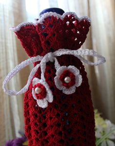 Give your gift touch of elegance with this beautiful crochet bottle cozy. This cozy is made from cotton thread #10. it will fit standard size and some larger wine bottle. Make your wine gift giving special.  Handmade by DoilyMania, etsy.com