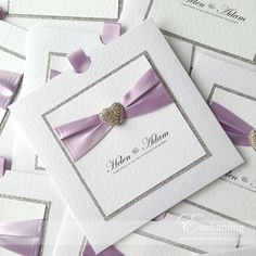 Stunning sparkly lilac wedding invitations | The Aurora Collection - Wallet Invitation | Featuring silver glitter paper, lilac ribbon and diamanté heart embellishment | Luxury handmade wedding invitations and stationery #byenchanting