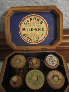 Antique Clark's spool cotton box with thread holes.