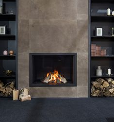 Beautiful and very realistic looking gas fire, glass enclosed with black frame. Leather wall cladding on the chimney breast by Home Fireplace, Modern Fireplace, Fireplace Design, Wall Fireplaces, Farmhouse Fireplace, Interior Cladding, Wall Cladding, Modern Interior Design, Luxury Interior