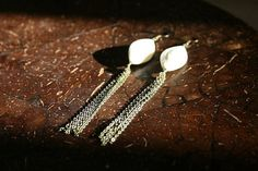 Long faux ivory and brass chain earrings by bluebegonia on Etsy, $25.00