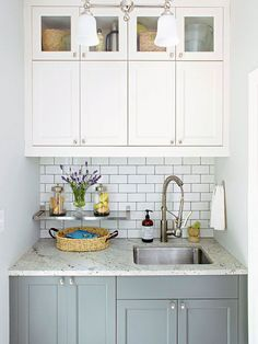 Wash Station  A granite countertop and a deep stainless-steel sink serve as a wash station between outdoors and inside. The clutter-free countertop is an ideal work surface for treating stains and rinsing off after outside activities. Small Space Laundry Room Storage, Laundry Rooms, Small Storage, Small Laundry, Laundry Storage, Storage Ideas, Laundry Room Design, Storage Room, Home Decor Inspiration