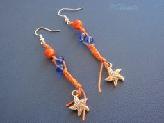 Brincos com jarina laranja, vidro azul, missangas laranja e berloque estrela do mar. ///  Earrings with orange tagua beads, glass beads, seedbeads and starfish charm. #ACBEADS #tagua #jarina #handmade