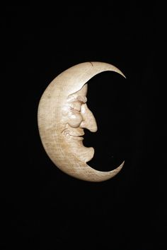 Moon carved out of wood....