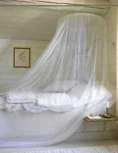 Mosquito protection in bedroom with sheer bed nets.